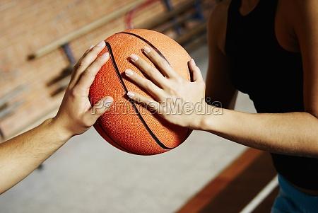 closeup of two basketball players playing