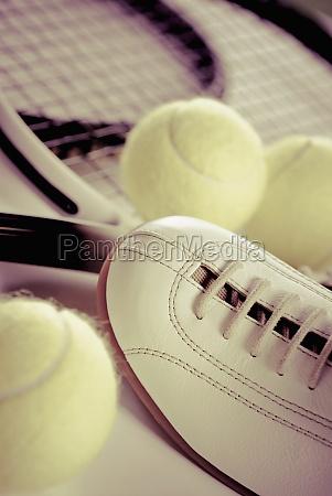 closeup of tennis rackets with tennis
