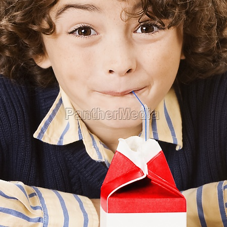 schoolboy drinking juice in a classroom