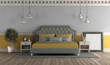 gray and yellow master bedroom in