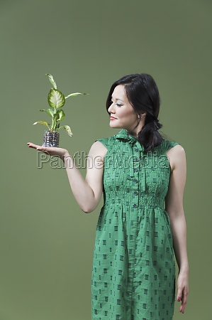 woman holding a seedling