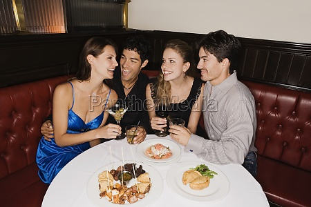 two young couples sitting at a