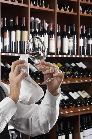 waiter polishing a wine glass