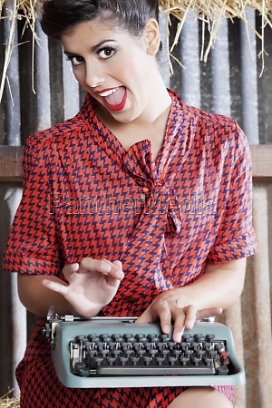 woman working on a typewriter and
