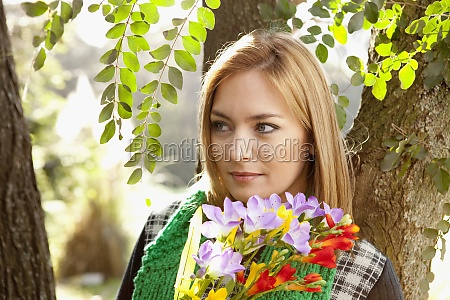 woman holding a bunch of flowers