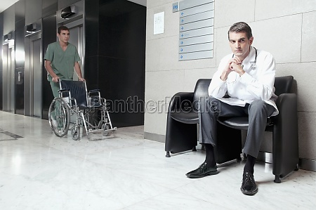 doctor and a male nurse in