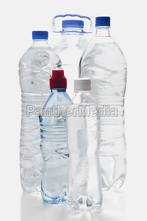 closeup of assorted bottles of water