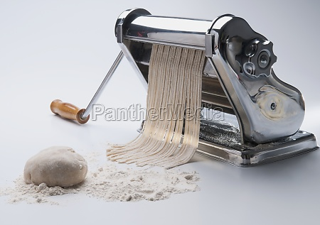 pasta being cut with a pasta
