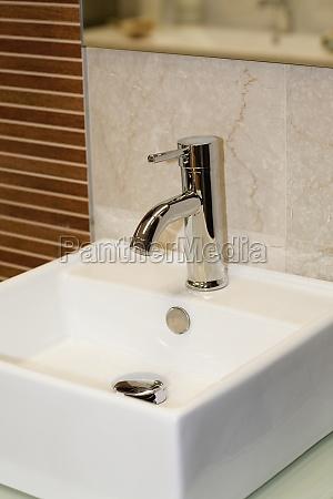 closeup of faucet on a bathroom