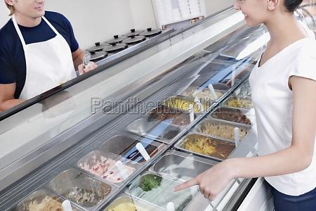 sales clerk attending a customer in