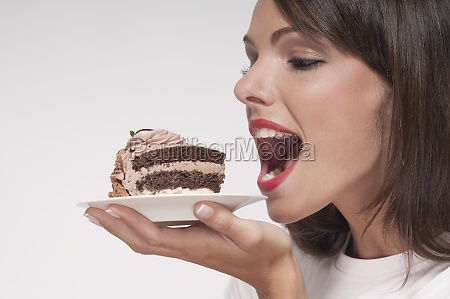 woman eating a pastry on a