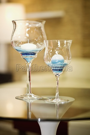 candles in stem glasses