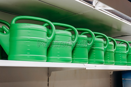 a lot of green watering cans