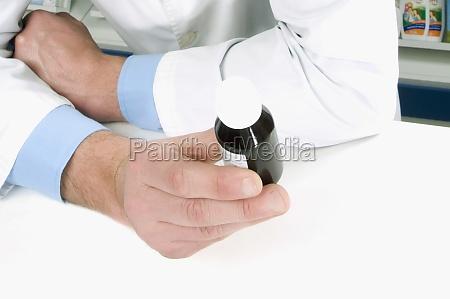 closeup of a pharmacistZs hand holding