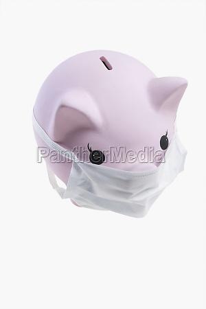 closeup of a piggy bank wearing