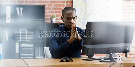 pondering praying african professional employee