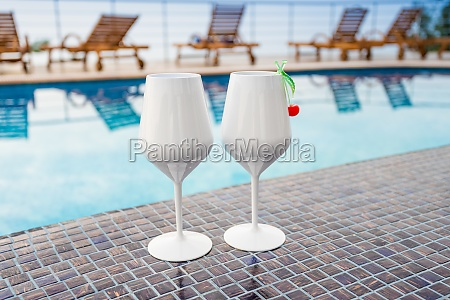 two cocktails near the swimming