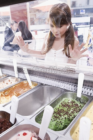 girl choosing ice cream in an