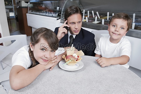 man with his two children in