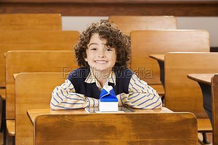 schoolboy smiling in a classroom