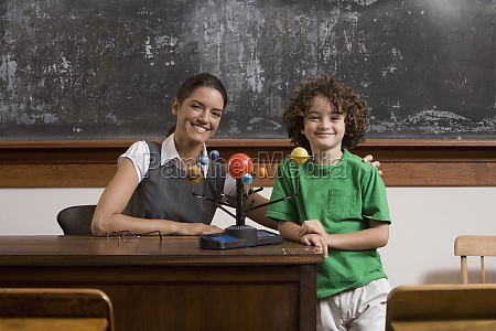 schoolboy and his teacher with model