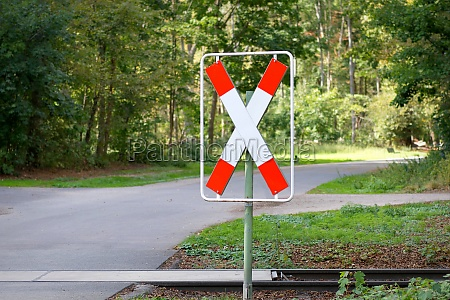 railroad crossing sign in front of
