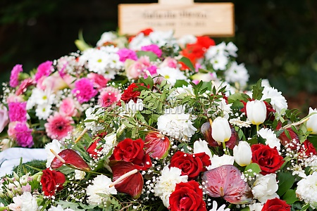 colorful flowers on a grave after