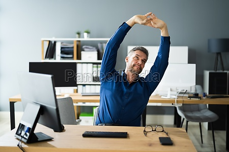 stretch exercise at office desk at
