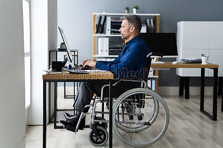 disabled handicapped man in wheelchair working