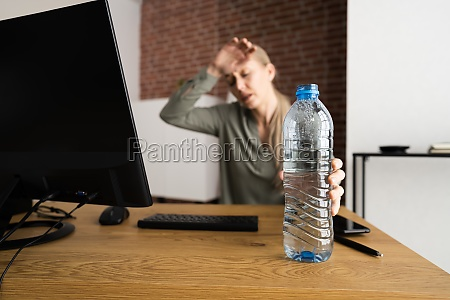 thirsty person working at desk
