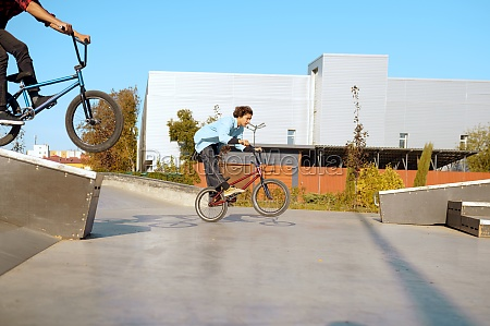 two male bmx bikers doing tricks