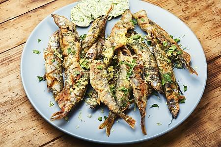 fried fish in frying pan