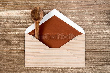 mail envelope with a wooden spoon