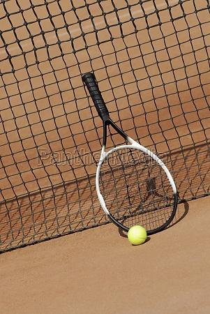 tennis racket a tennis ball against