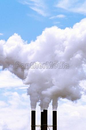 smoke emitting from a smoke stack
