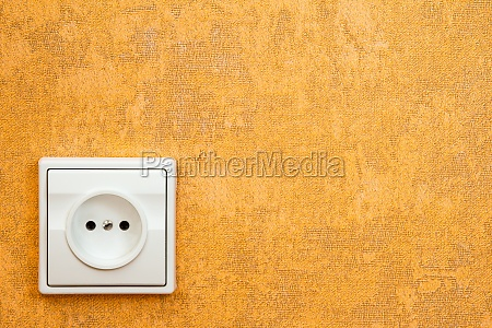 outlet mounted on yellow wall