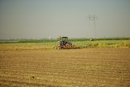 tractor plowing a farm