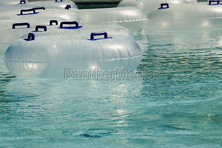 inflatable rings floating in a pool