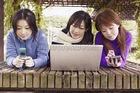three young women lying in front