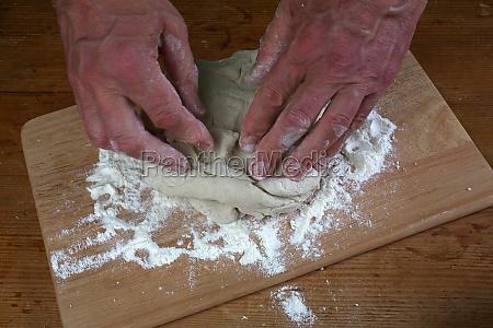 baker preparing some dough ready to