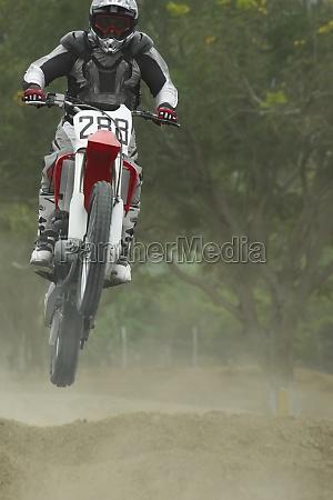 motocross rider performing a jump on