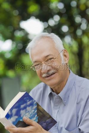 portrait of a senior man holding