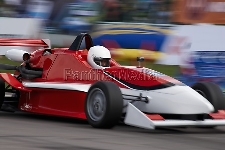racecar racing on a motor racing
