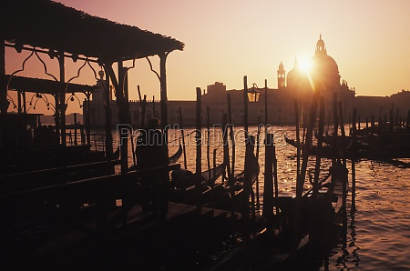gondolas moored at a dock