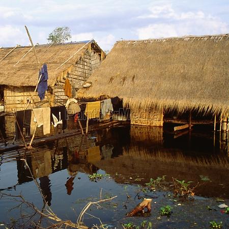 huts in a flooded village siem