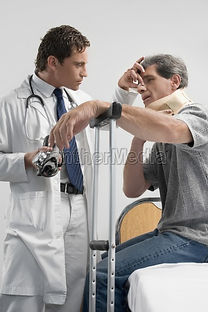 male doctor examining a patient in