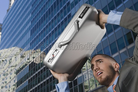 businessman using his briefcase as a