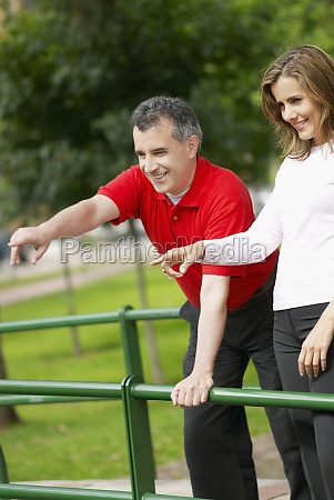 mid adult couple pointing forward