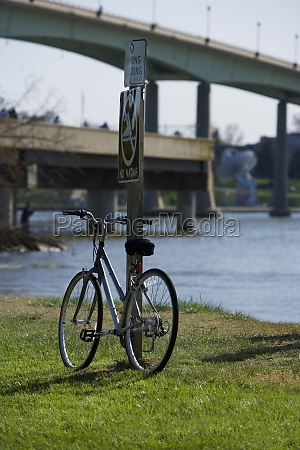 bicycle leaning against a pole annapolis