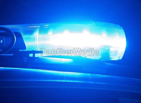 police car with blue light at